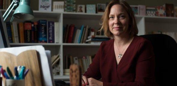 Miranda Griffin sitting at her desk